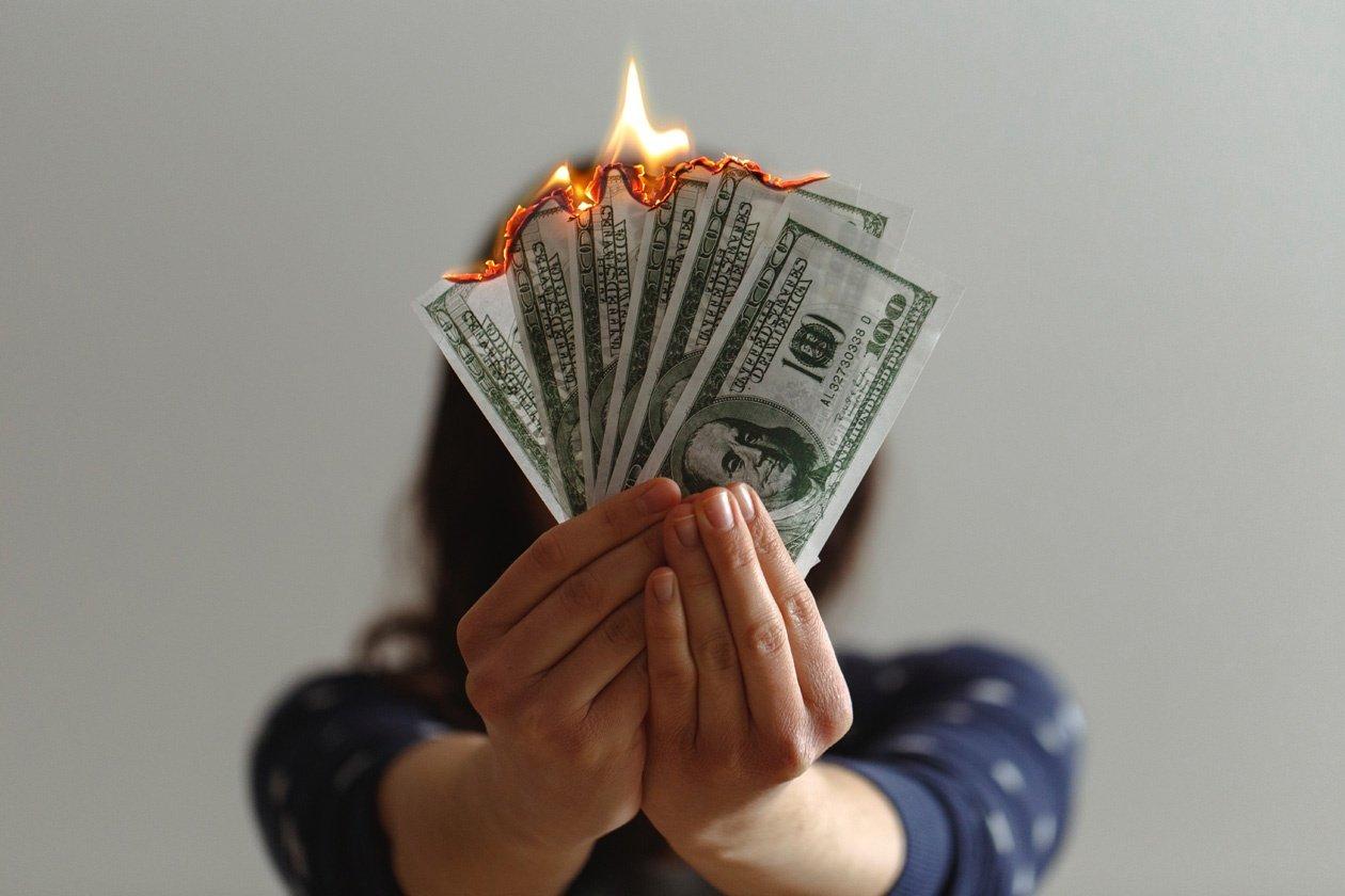 Lady Burning Money - Save Money on Heating Bills