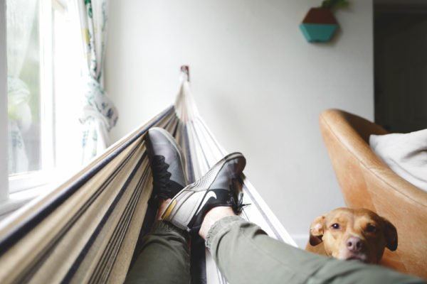 person laying on a hammock cooling your summer home