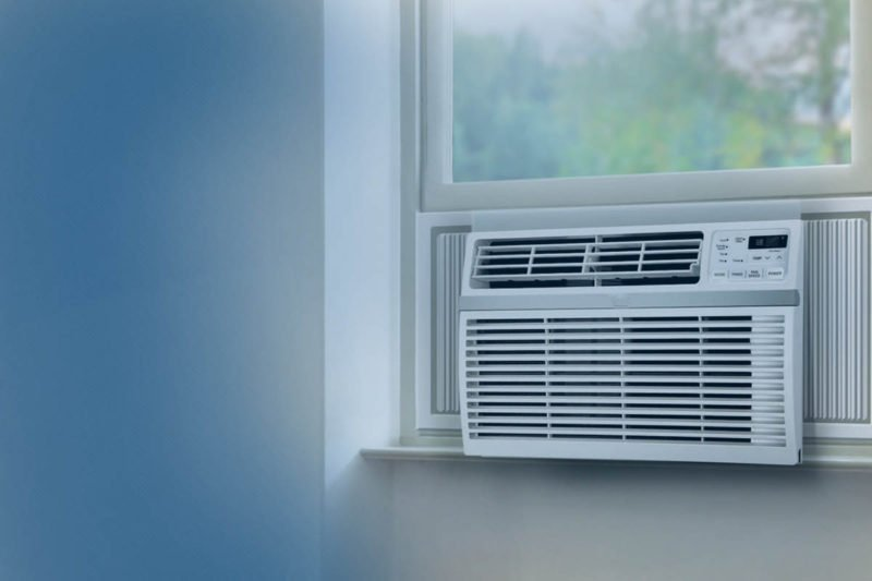 Air conditioner on a window sill